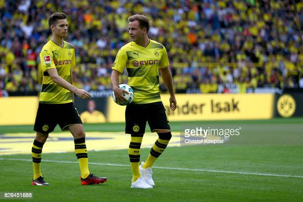 Julian Weigl and Mario Goetze are seen during the Borussia Dortmund Season Opening 2017/18 at Signal Iduna Park on August 4 2017 in Dortmund Germany