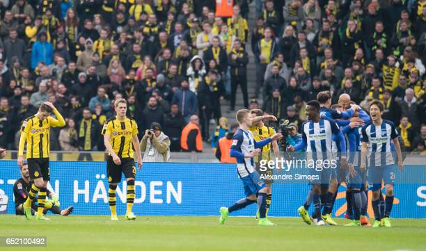 Julian Weigl and Matthias Ginter of Borussia Dortmund after receiving the goal to the 21 during the Bundesliga match between Hertha BSC and Borussia...