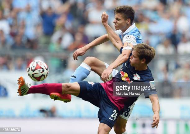 Julian Weigl of 1860 Muenchen in action against Dominik Kaiser of RB Leipzig during the Second Bundesliga match between TSV 1860 Muenchen and RB...