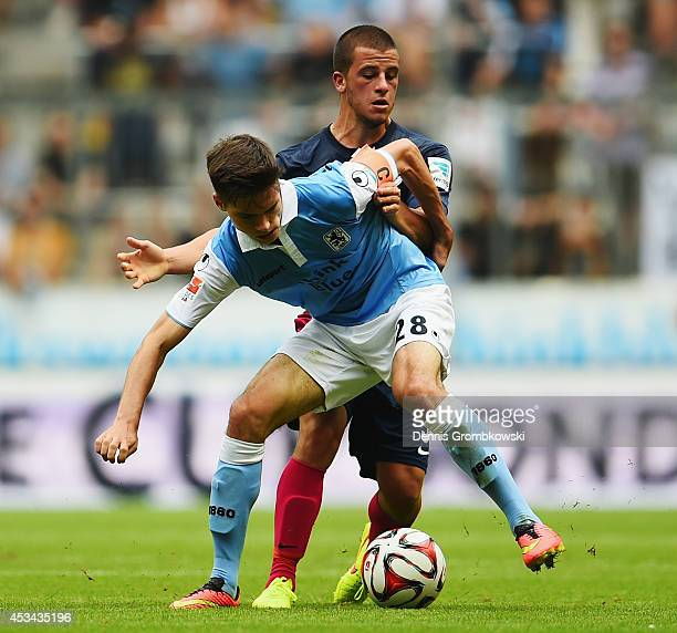 Julian Weigl of 1860 Muenchen is challenged by Anthony Jung of RB Leipzig during the Second Bundesliga match between TSV 1860 Muenchen and RB Leipzig...