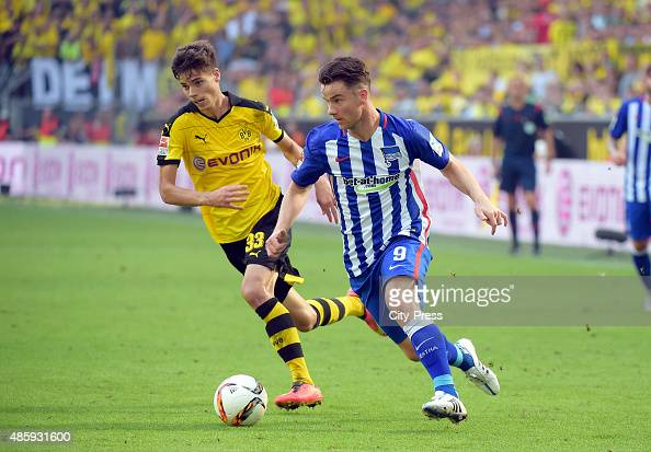 Julian Weigl of Borussia Dortmund and Alexander Baumjohann of Hertha BSC during the game between Borussia Dortmund and Hertha BSC on August 30 2015...