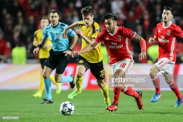 Julian Weigl of Borussia Dortmund and Eduardo Salvio of Benfica Lisbon battle for the ball during their UEFA Champions League Round of 16 1st leg...