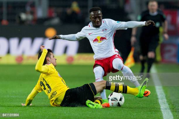 Julian Weigl of Borussia Dortmund and Naby Deco Keita of RB Leipzig battle for the ball during the Bundesliga soccer match between Borussia Dortmund...