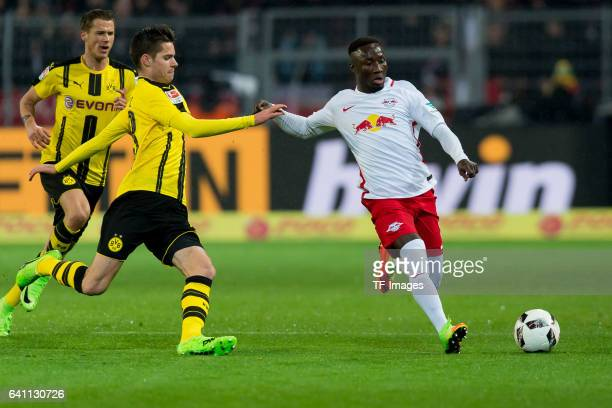 Julian Weigl of Borussia Dortmund and Naby Keita of RB Leipzig battle for the ball during the Bundesliga soccer match between Borussia Dortmund and...
