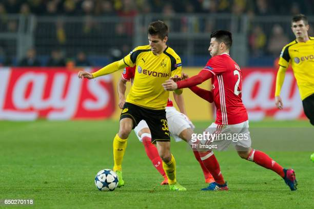 Julian Weigl of Borussia Dortmund and Pizzi of Benfica battle for the ball during the UEFA Champions League Round of 16 Second Leg match between...