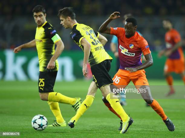 Julian Weigl of Borussia Dortmund and Vinicius of Apoel FC battle for possession during the UEFA Champions League group H match between Borussia...