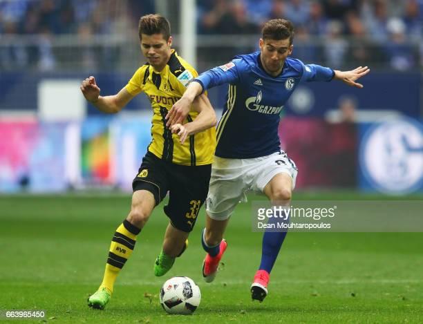 Julian Weigl of Borussia Dortmund battles for the ball with Leon Goretzka of Schalke during the Bundesliga match between FC Schalke 04 and Borussia...