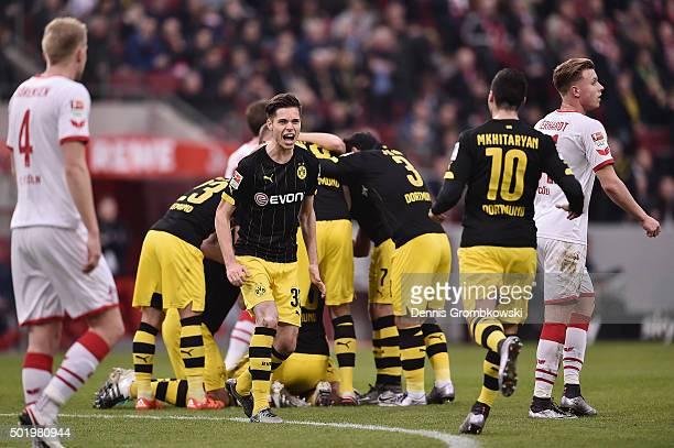 Julian Weigl of Borussia Dortmund celebrates with team mate Henrikh Mkhitaryan as Sokratis scores the opening goal during the Bundesliga match...
