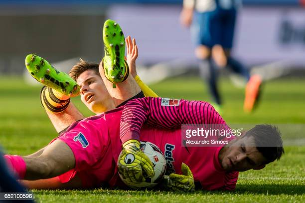 Julian Weigl of Borussia Dortmund challenges Rune Jarstein of Hertha BSC during the Bundesliga match between Hertha BSC and Borussia Dortmund at the...