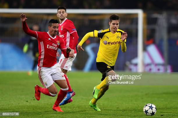 Julian Weigl of Borussia Dortmund competes with Andre Almeida of SL Benfica during the UEFA Champions League Round of 16 second leg match between...