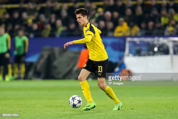 Julian Weigl of Borussia Dortmund controls the ball during the UEFA Champions League Round of 16 Second Leg match between Borussia Dortmund and SL...