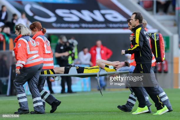 Julian Weigl of Borussia Dortmund got injured during the Bundesliga match between FC Augsburg and Borussia Dortmund at the WWKArena on May 13 2017 in...