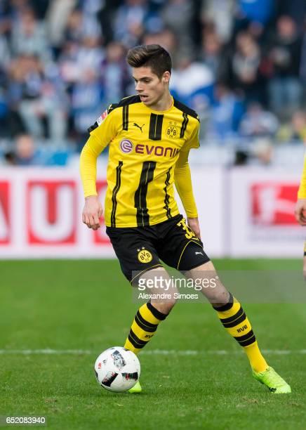 Julian Weigl of Borussia Dortmund in action during the Bundesliga match between Hertha BSC and Borussia Dortmund at the Olympiastadion on March 11...