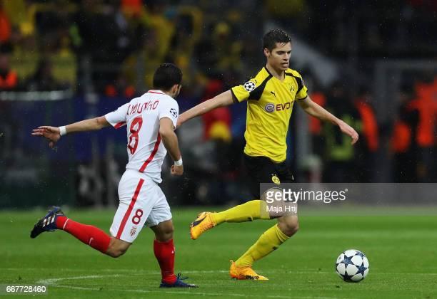 Julian Weigl of Borussia Dortmund is closed down by Joao Moutinho of AS Monaco during the UEFA Champions League Quarter Final first leg match between...