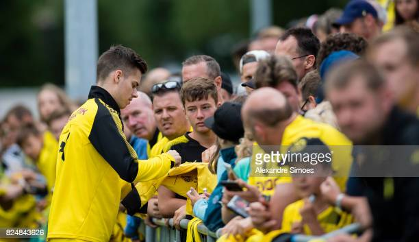 Julian Weigl of Borussia Dortmund is giving autographs to the fans after a training session as part of the training camp on July 31 2017 in Bad Ragaz...
