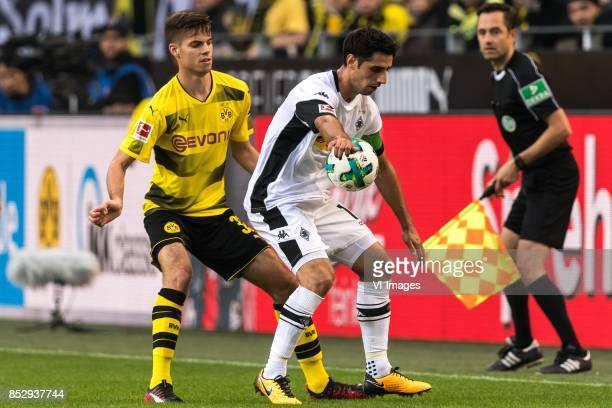 Julian Weigl of Borussia Dortmund Lars Stindl of Borussia Monchengladbach during the Bundesliga match between Borussia Dortmund and Borussia...