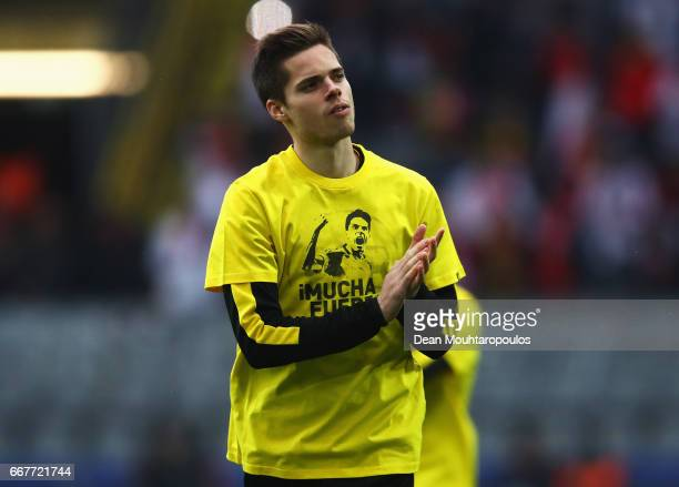 Julian Weigl of Borussia Dortmund wears a shirt for Marc Bartra who was injured in the team coach attack prior to the UEFA Champions League Quarter...