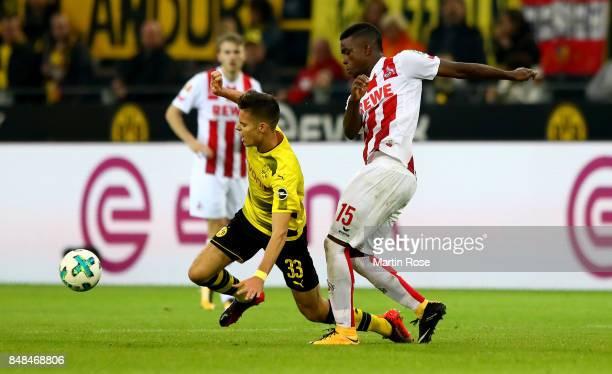Julian Weigl of Dortmund and Copete Cordiba of Koeln battle for the ball during the Bundesliga match between Borussia Dortmund and 1 FC Koeln at...