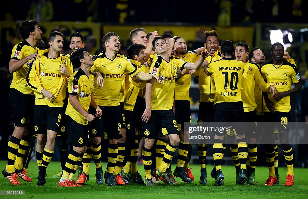 Julian Weigl of Dortmund and his team mates celebrate after winning the Bundesliga match between Borussia Dortmund and FC Schalke 04 at Signal Iduna Park on November 8, 2015 in Dortmund, Germany.