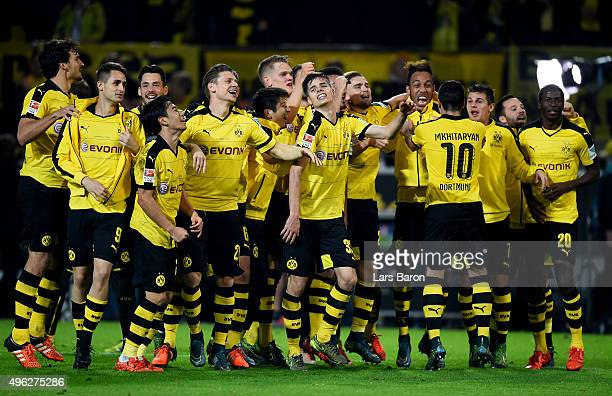 Julian Weigl of Dortmund and his team mates celebrate after winning the Bundesliga match between Borussia Dortmund and FC Schalke 04 at Signal Iduna...
