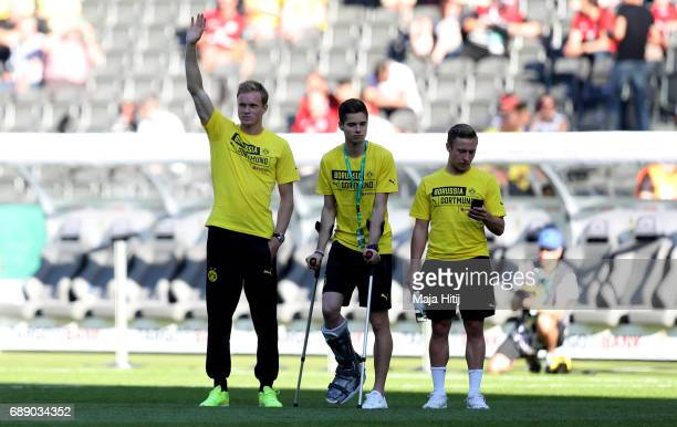 Julian Weigl of Dortmund and his team mates walk on the pitch ahead of the DFB Cup final match between Eintracht Frankfurt and Borussia Dortmund at...