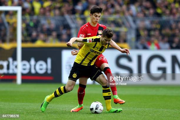 Julian Weigl of Dortmund and Kai Havertz of Leverkusen battle for the ball during the Bundesliga match between Borussia Dortmund and Bayer 04...