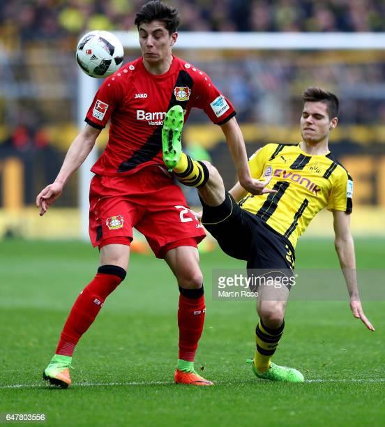 Julian Weigl of Dortmund and Kai Havertz of Leverkusen battle for the ball during the Bundesliga match between Borussia Dortmund and Bayer 04...
