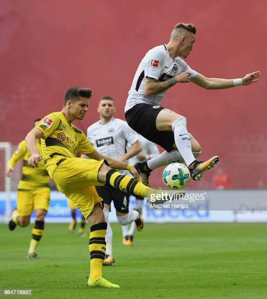 Julian Weigl of Dortmund and Marius Wolf of Frankfurt fight of the ball during the Bundesliga match between Eintracht Frankfurt and Borussia Dortmund...