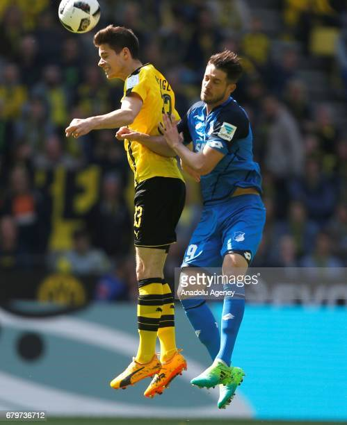 Julian Weigl of Dortmund and Mark Uth of Hoffenheim fight for the ball during the Bundesliga soccer match between Borussia Dortmund and TSG...