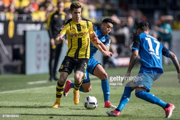 Julian Weigl of Dortmund and Nadiem Amiri of Hoffenheim battle for the ball during the Bundesliga match between Borussia Dortmund and TSG 1899...