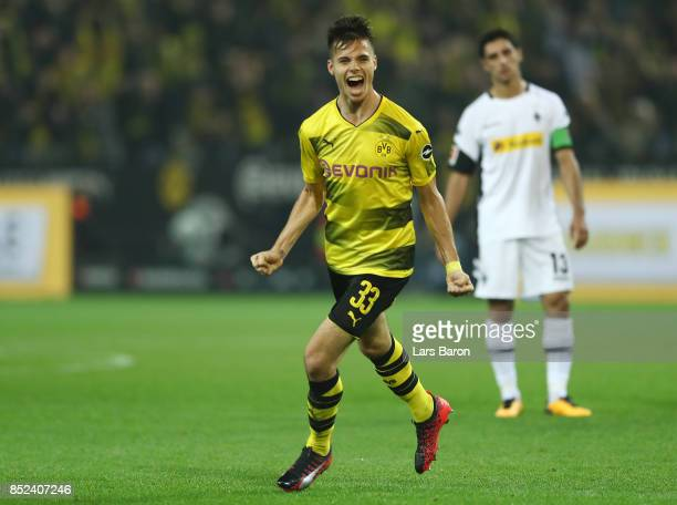 Julian Weigl of Dortmund celebrates after he scored his teams sixth goal to make it 61 during the Bundesliga match between Borussia Dortmund and...