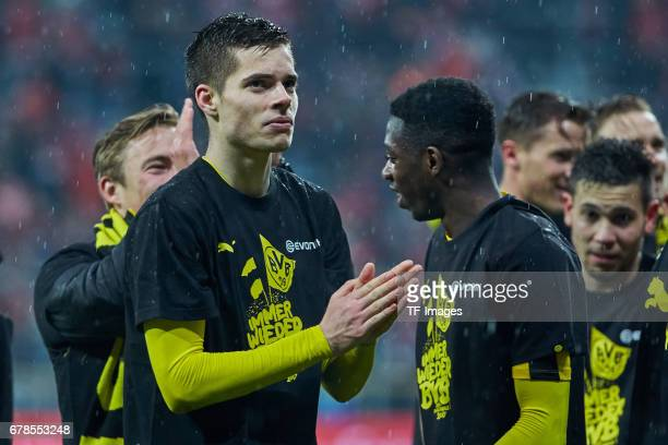 Julian Weigl of Dortmund celebrates the win after the final whistle during the German Cup semi final soccer match between FC Bayern Munich and...