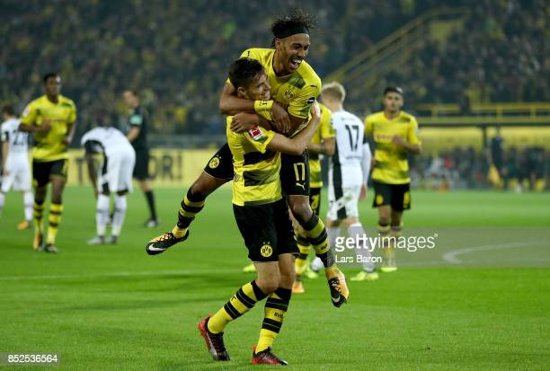 Julian Weigl of Dortmund celebrates with team mate Pierre Emerick Aubameyang of Dortmund after scoring his teams sixth goal during the Bundesliga...
