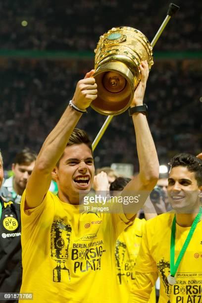 Julian Weigl of Dortmund celebrates with the trophy after winning the DFB Cup final match between Eintracht Frankfurt and Borussia Dortmund at...