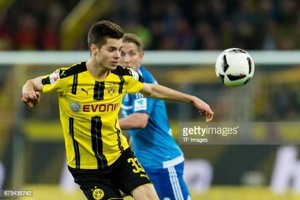 Julian Weigl of Dortmund controls the ball during the Bundesliga match between Borussia Dortmund and Hamburger SV at Signal Iduna Park on April 4...