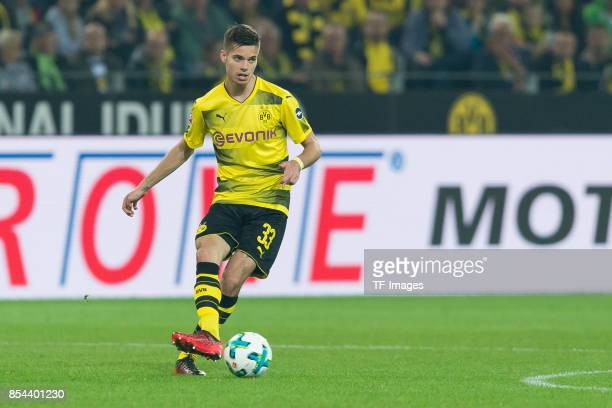 Julian Weigl of Dortmund controls the ball during the Bundesliga match between Borussia Dortmund and Borussia Moenchengladbach at Signal Iduna Park...
