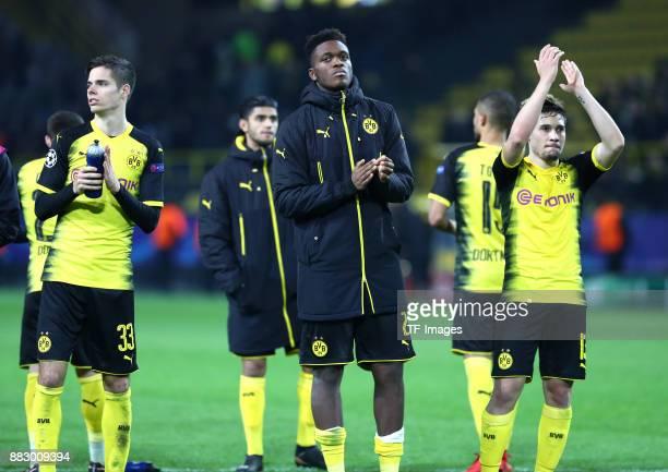 Julian Weigl of Dortmund DanAxel Zagadou of Dortmund and Raphael Guerreiro of Dortmund gesture after the UEFA Champions League group H match between...