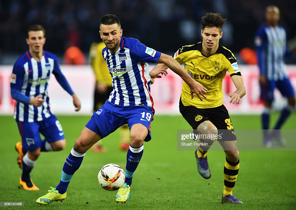 Julian Weigl of Dortmund is challenged by <a gi-track='captionPersonalityLinkClicked' href=/galleries/search?phrase=Vedad+Ibisevic&family=editorial&specificpeople=535857 ng-click='$event.stopPropagation()'>Vedad Ibisevic</a> of Berlin during the Bundesliga match bewteen Hertha BSC and Borussia Dortmund at Olympiastadion on February 6, 2016 in Berlin, Germany.