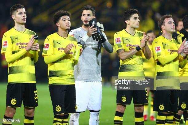 Julian Weigl of Dortmund Jadon Sancho of Dortmund Roman Bürki Marc Bartra of Dortmund and Mario Goetze of Dortmund looks dejected after the German...