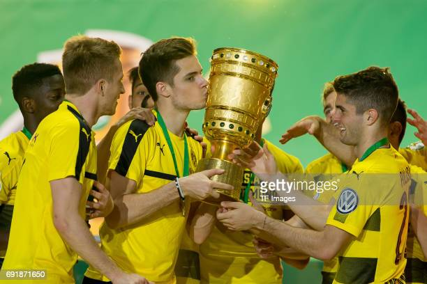 Julian Weigl of Dortmund kisses the DFB cup trophy after the DFB Cup final match between Eintracht Frankfurt and Borussia Dortmund at Olympiastadion...