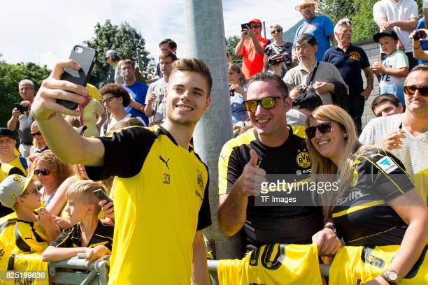Julian Weigl of Dortmund make a selfie with fans during a training session as part of the training camp on July 29 2017 in Bad Ragaz Switzerland