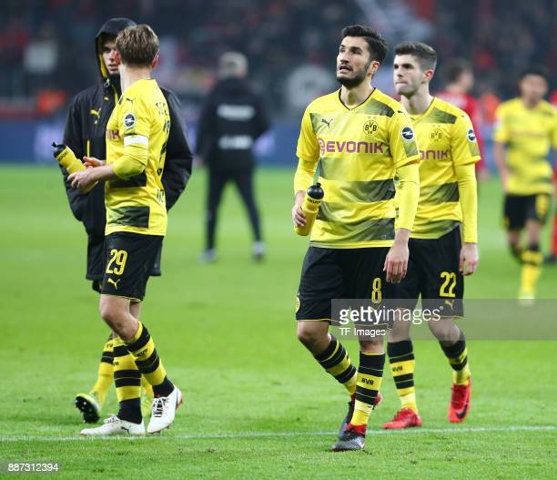 Julian Weigl of Dortmund Marcel Schmelzer of Dortmund Nuri Sahin of Dortmund and Christian Pulisic of Dortmund look dejected after the Bundesliga...