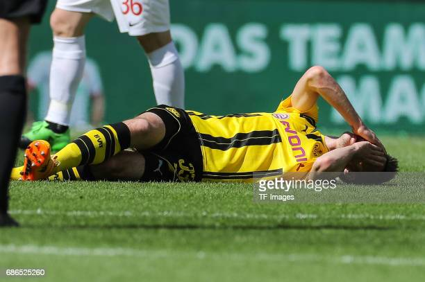 Julian Weigl of Dortmund on the ground during the Bundesliga match between FC Augsburg and Borussia Dortmund at the WWKArena on May 13 2017 in...