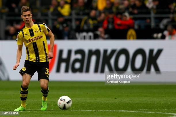 Julian Weigl of Dortmund runs with the ball during the Bundesliga match between Borussia Dortmund and VfL Wolfsburg at Signal Iduna Park on February...