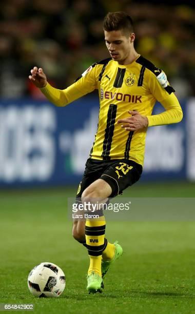 Julian Weigl of Dortmund runs with the ball during the Bundesliga match between Borussia Dortmund and FC Ingolstadt 04 at Signal Iduna Park on March...