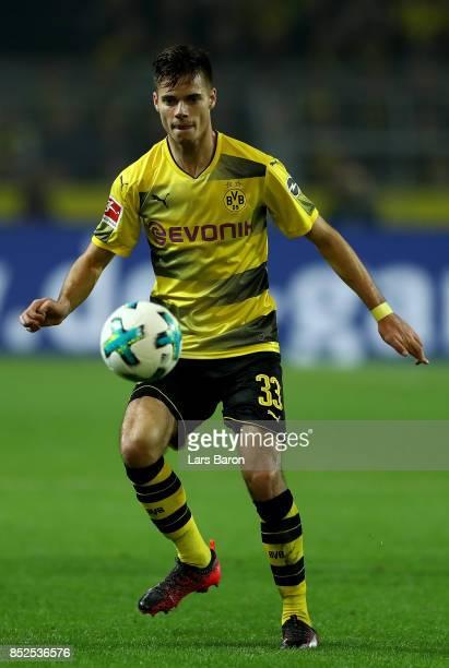 Julian Weigl of Dortmund runs with the ball during the Bundesliga match between Borussia Dortmund and Borussia Moenchengladbach at Signal Iduna Park...