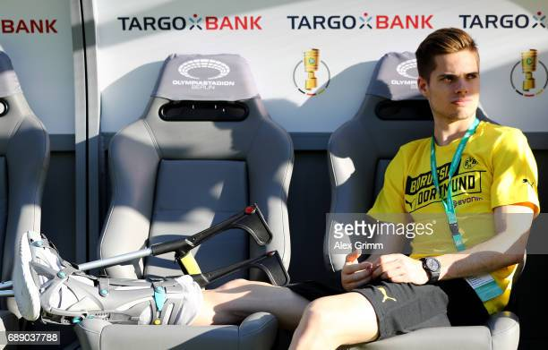 Julian Weigl of Dortmund sits on the bench ahead of the DFB Cup final match between Eintracht Frankfurt and Borussia Dortmund at Olympiastadion on...