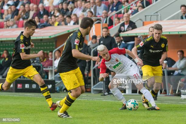 Julian Weigl of Dortmund Sokratis Papastathopoulos of Dortmund Philipp Max of Augsburg and Lukasz Piszczek of Dortmund battle for the ball during the...