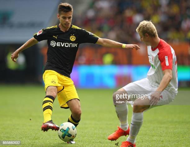 Julian Weigl of Dortmund with Martin Hinteregger of Augsburg during the Bundesliga match between FC Augsburg and Borussia Dortmund at WWKArena on...