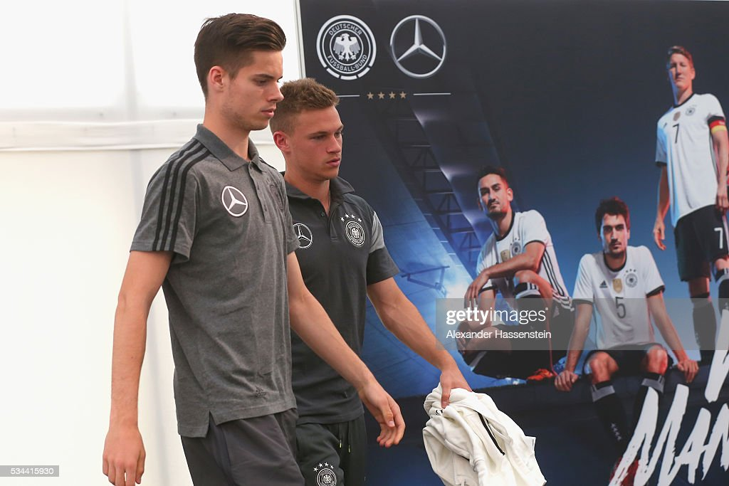 Julian Weigl (L) of Germany and his team mate <a gi-track='captionPersonalityLinkClicked' href=/galleries/search?phrase=Joshua+Kimmich&family=editorial&specificpeople=9479434 ng-click='$event.stopPropagation()'>Joshua Kimmich</a> arrive for a press conference on day 3 of the German national team trainings camp on May 26, 2016 in Ascona, Switzerland.